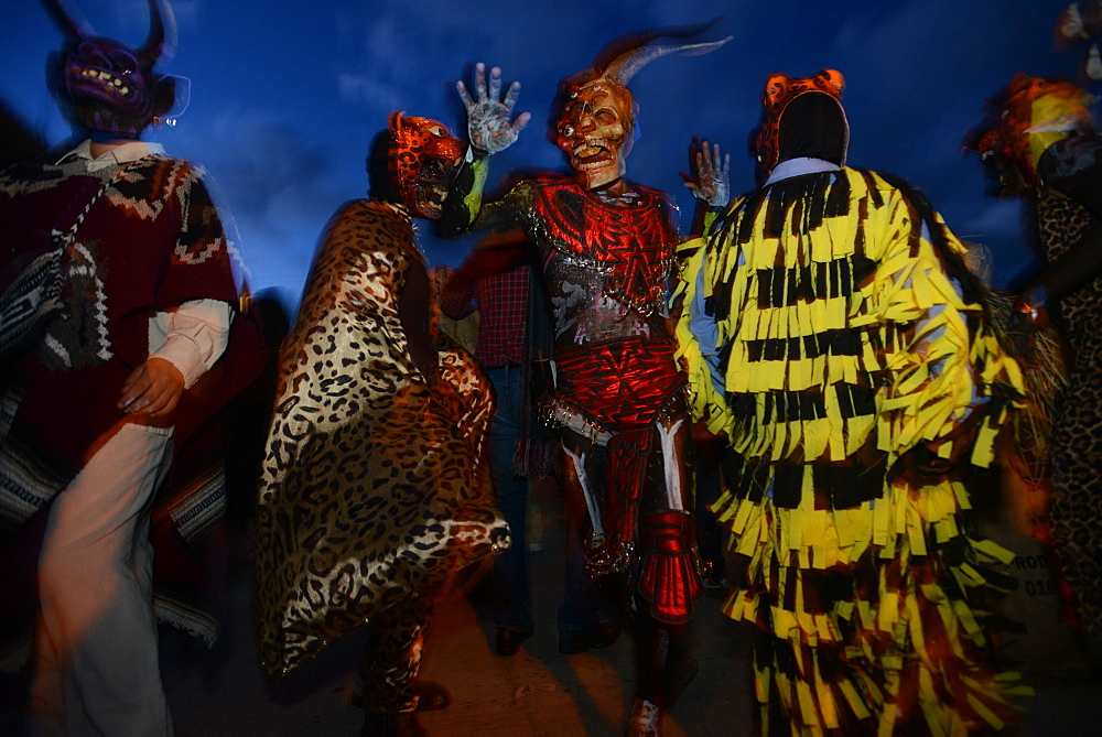 Comparsas or street dances at the village of Yahuche where people disguise as mythical creatures