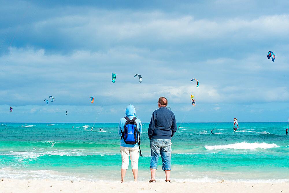 People watching the kite surfers, Flag Beach, Fuerteventura, Canary Islands, Spain, Atlantic, Europe