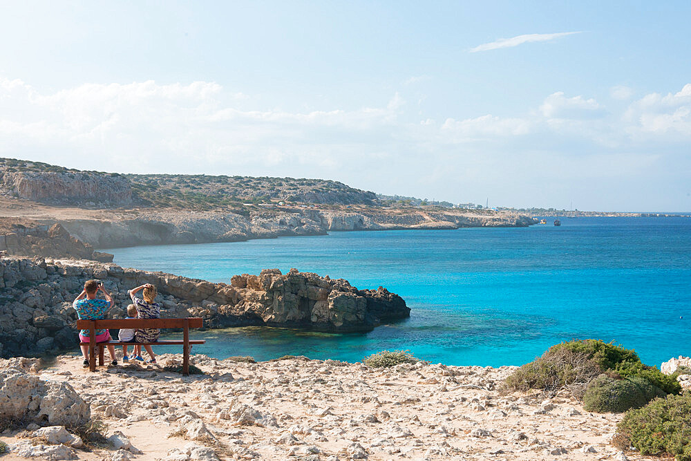 Family looking out over Cape Greco, Protaras, Cyprus, Mediterranean, Europe