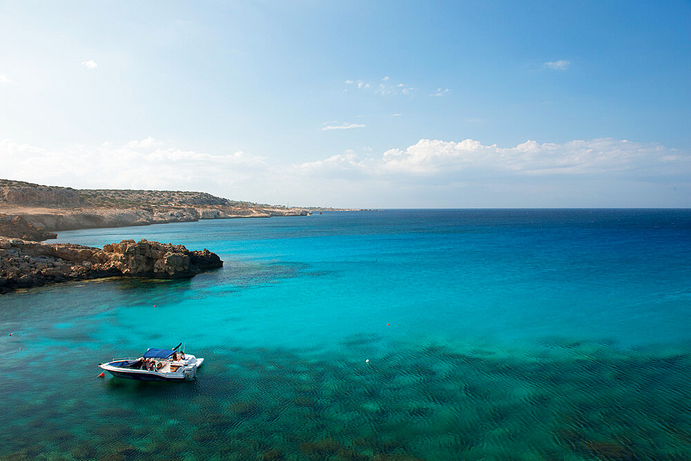Boat in the water overlooking Cape Greco, Protaras, Cyprus, Mediterranean, Europe