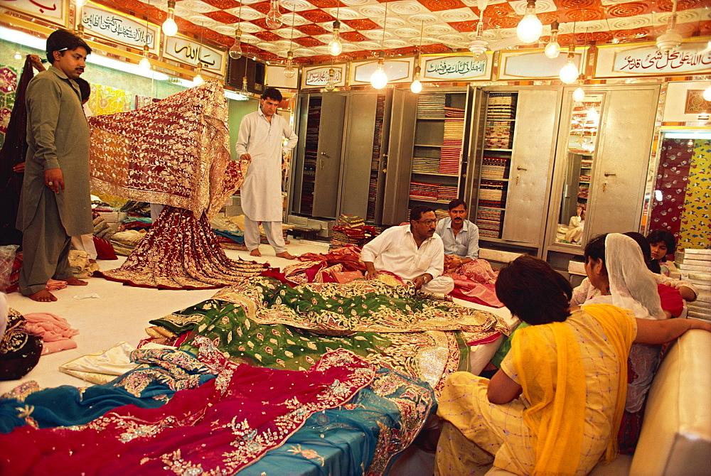 Textile and silk sari shop, Anarkali Bazaar, Lahore, Pakistan, Asia