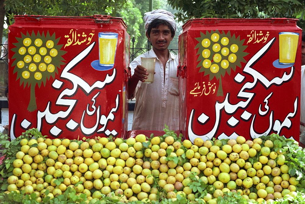 Citrus fruit vendor at Lahore City Fort, Lahore, Pakistan, Asia