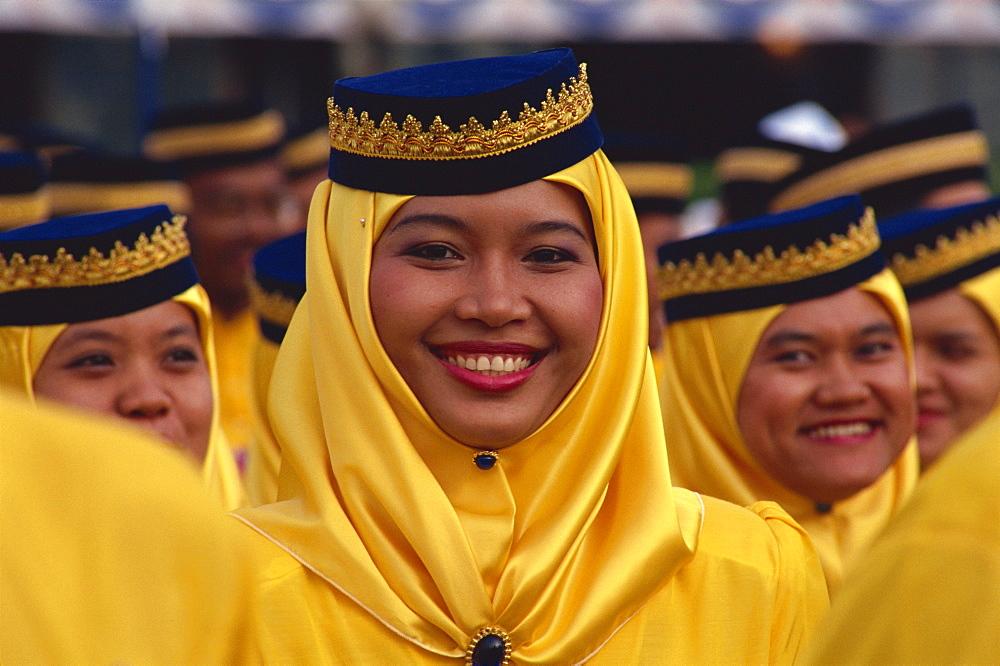 Girl in traditional Malay dress, Kuala Lumpur, Malaysia, Southeast Asia, Asia - 142-4132