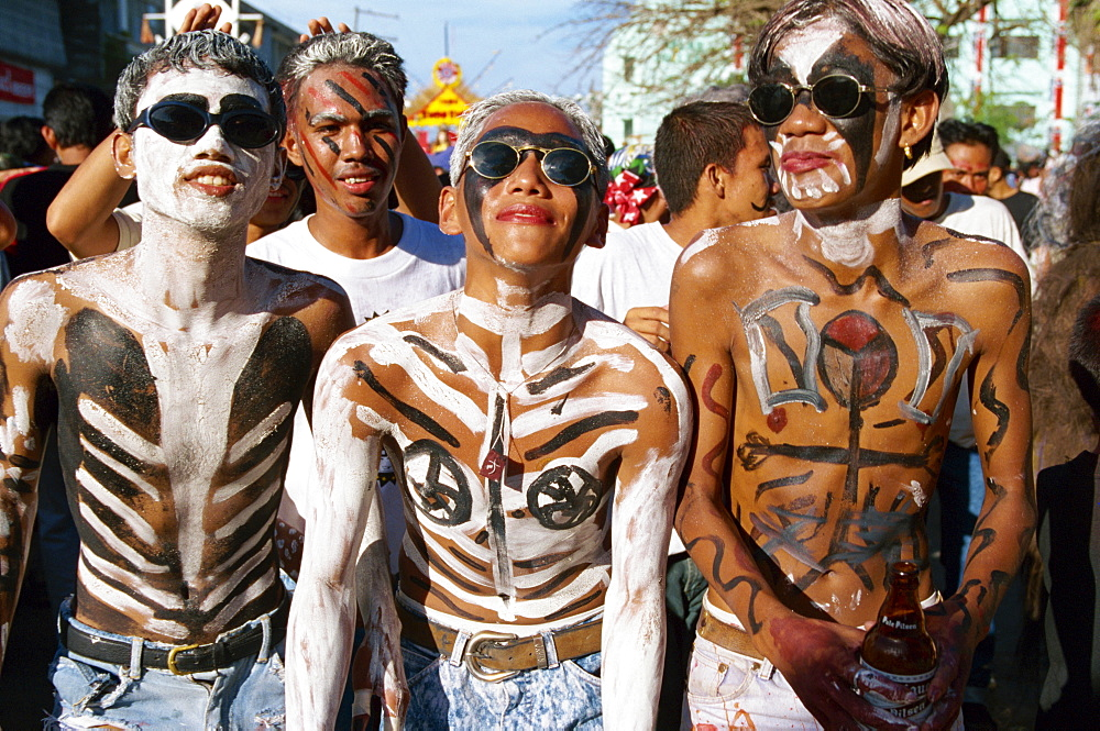 A group of men with body decoration and sunglasses during the Mardi Gras, Ati Atihan, at Kalico on Panay Island, Philippines, Southeast Asia, Asia