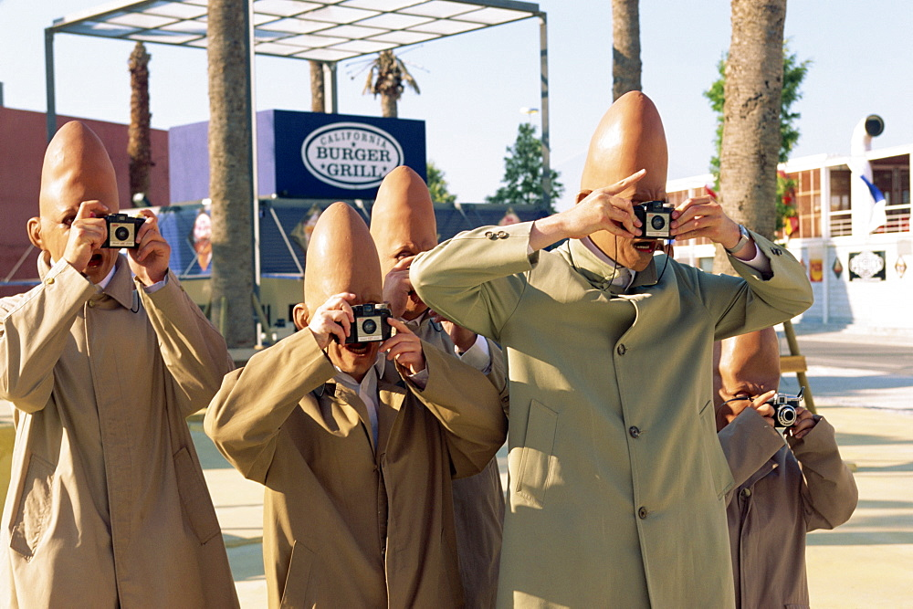 Alien tourists in comedy street show, Expo '98, Lisbon, Portugal, Europe
