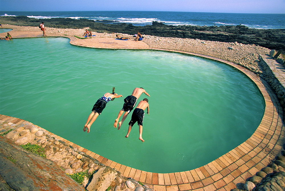 Three children diving into a swimming pool, South Africa, Africa - 142-5844
