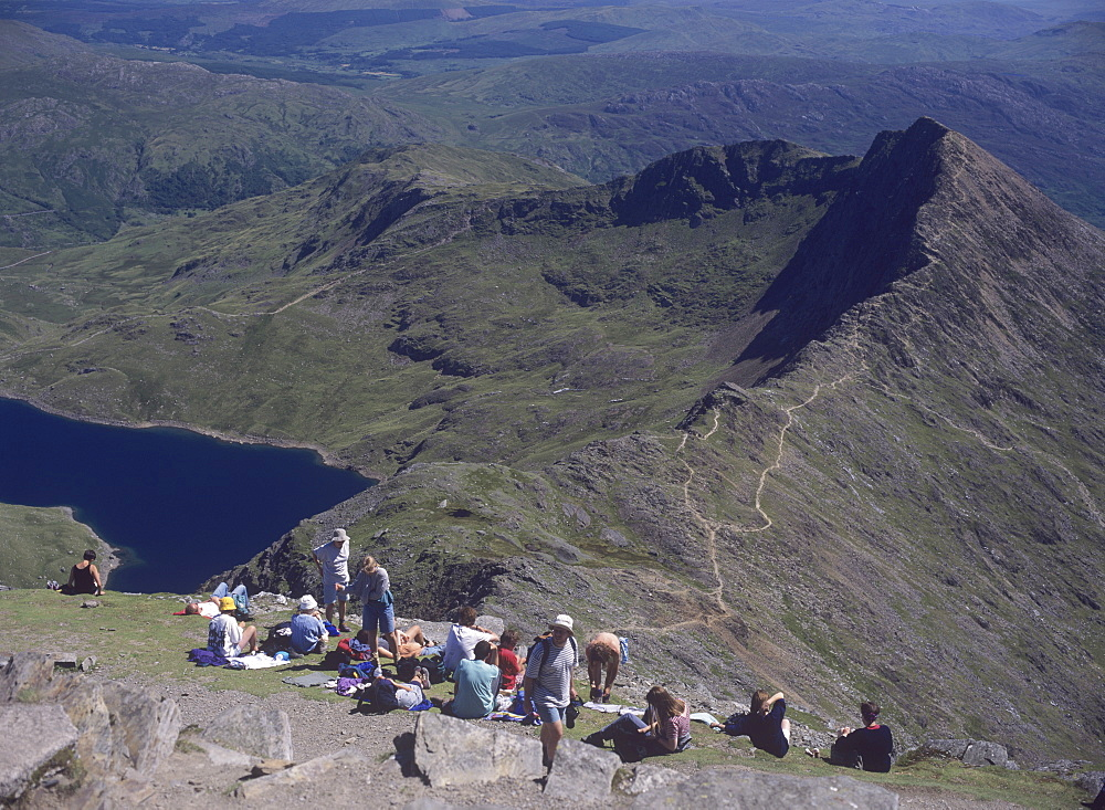 Walkers relaxing at the summit of Mount Snowdon, with Llyn Llydaw reservoir and the ridge of Y Lliwedd below, Snowdonia National Park, North Wales, Wales, United Kingdom, Europe - 16-2999