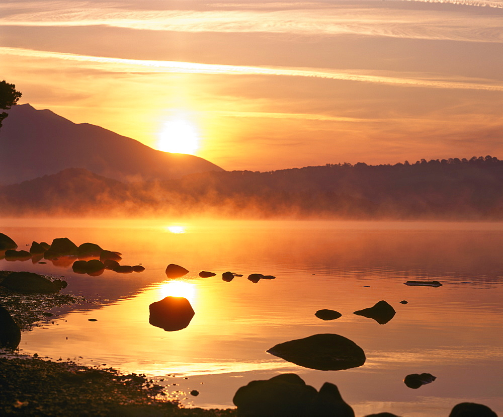 Mist rising on Derwent Water at sunrise, Lake District National Park, Cumbria, England, United Kingdom, Europe - 16-3189