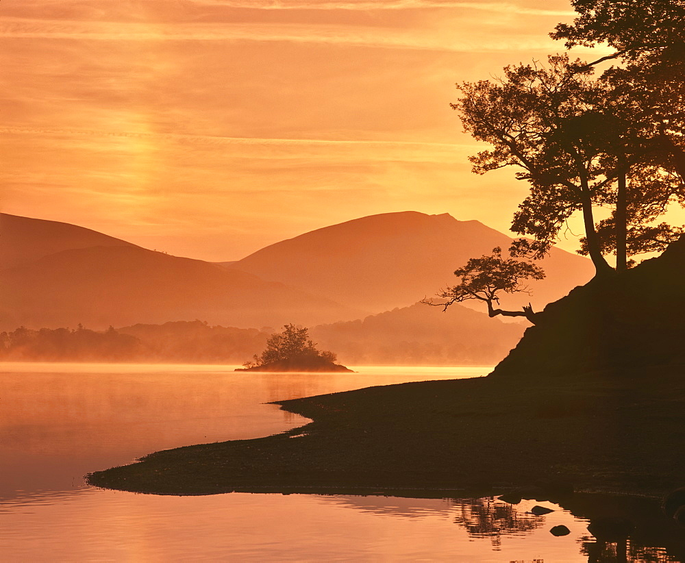 Mist rising on Derwent Water at dawn, Lake District National Park, Cumbria, England, United Kingdom, Europe - 16-3191