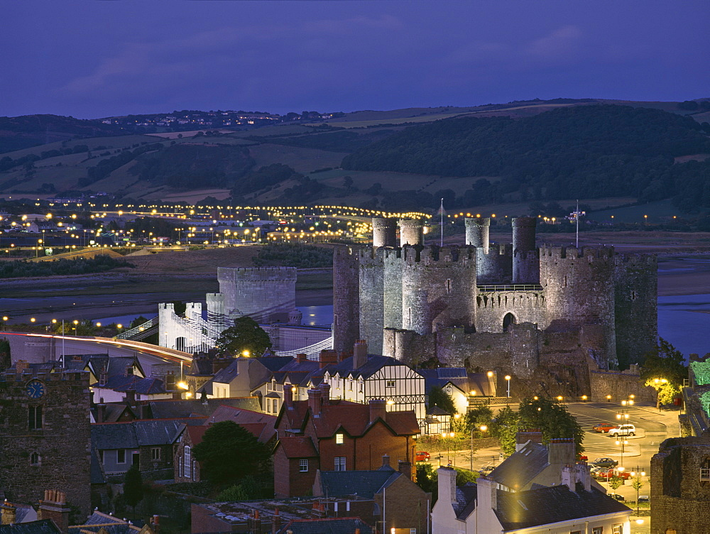 Floodlit Conwy Castle, UNESCO World Heritage Site, overlooking the town with the River Conwy estuary beyond at dusk, Gwynedd, North Wales, United Kingdom, Europe - 16-3236