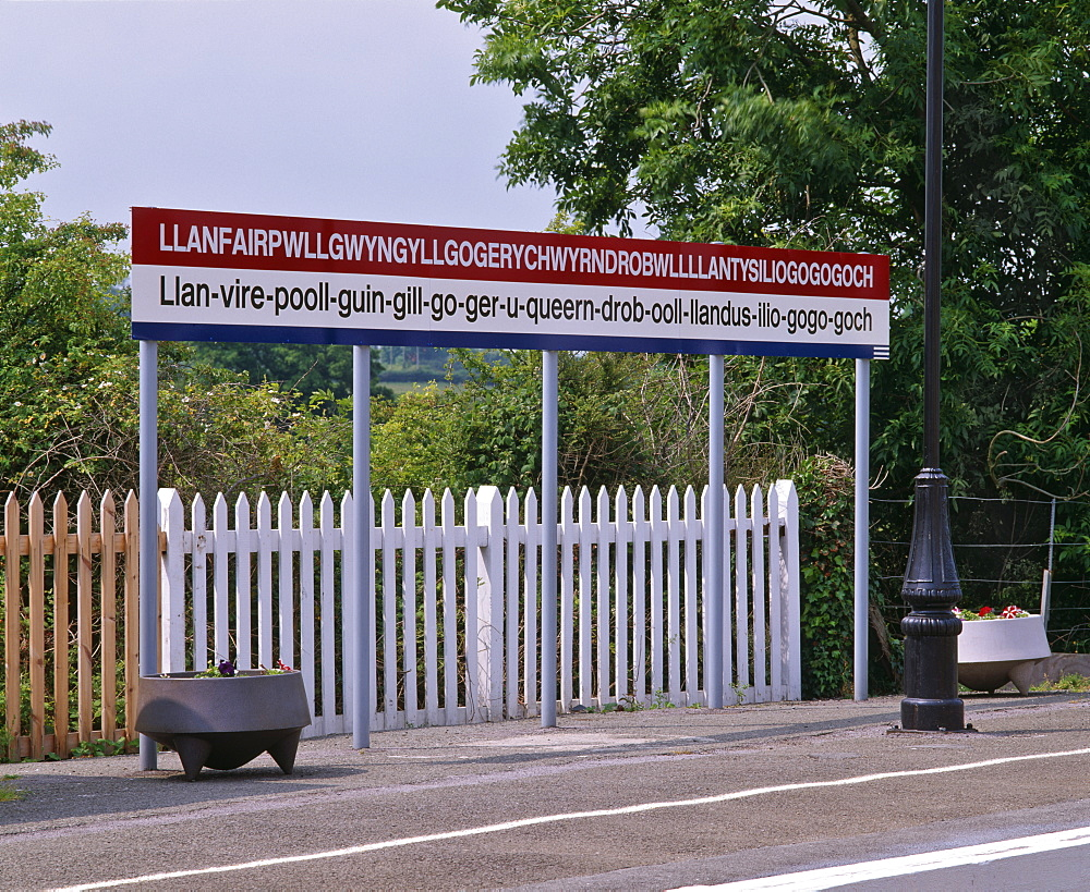 Station sign at Llanfairpwllgwyngyllgo-gerychwyrndrobwllllantysiliogogogoch (Llanfair-PG.), Anglesey, North Wales, United Kingdom, Europe - 16-3247