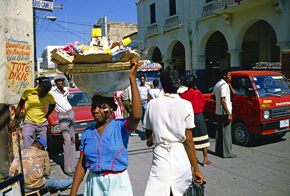 Street scene, including woman carrying goods on head, Port au Prince, Haiti, Caribbean, Central America