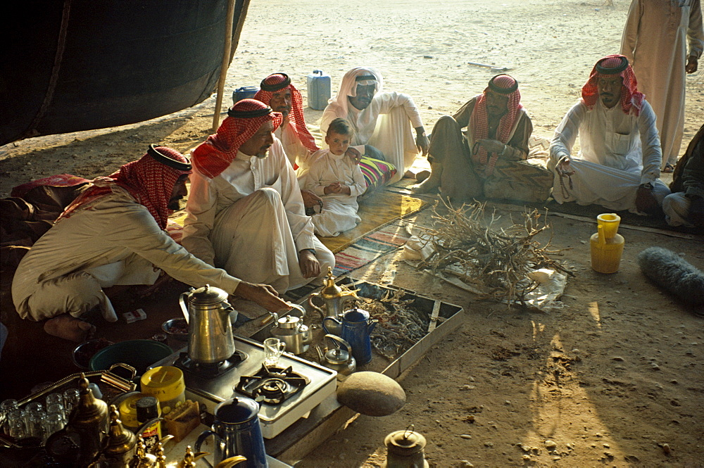 Group of men in Bedouin tent, Saudi Arabia, Middle East