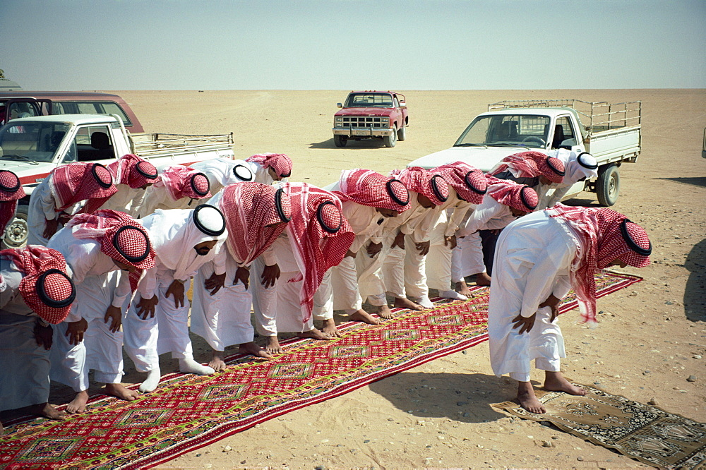 Group of Bedouin men at prayer, Saudi Arabia, Middle East