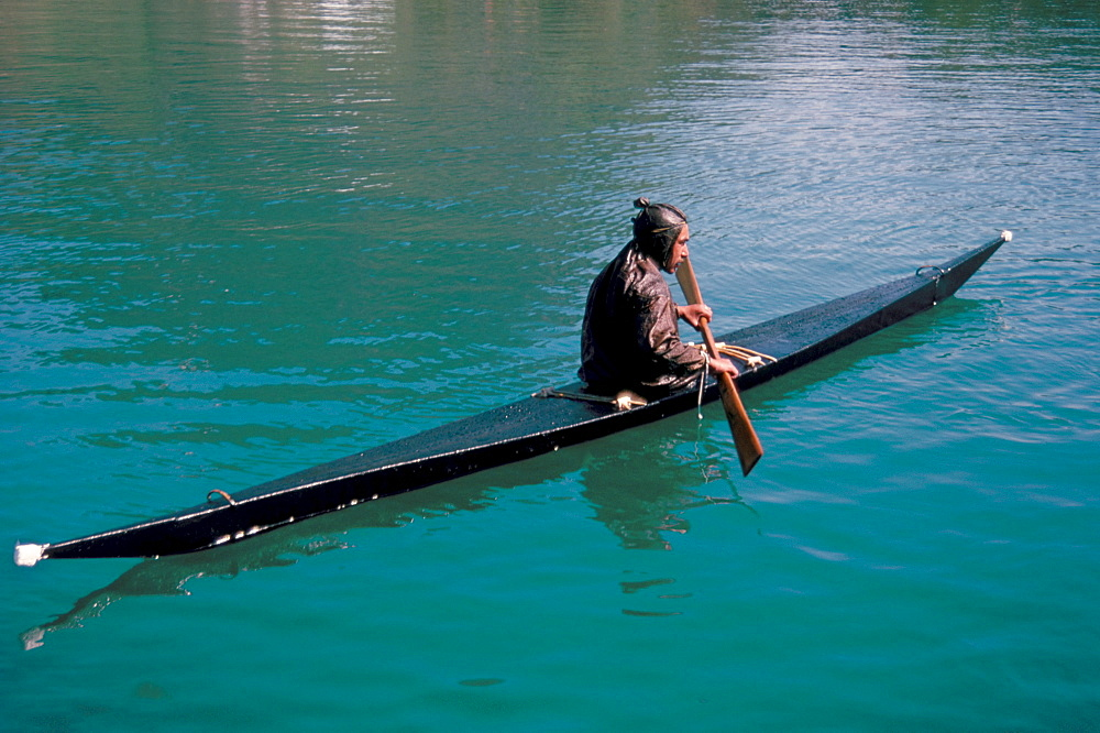 Inuit in traditional kayak, Greenland, Polar Regions