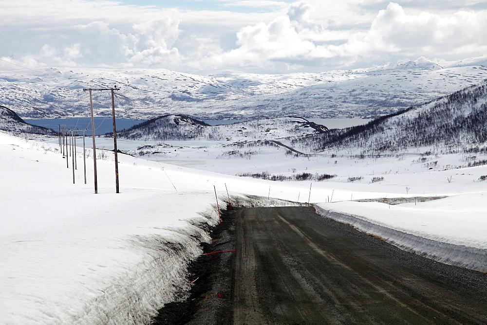 Mountain road in spring, Kvaloya (Whale Island), Troms, arctic Norway, Scandinavia, Europe - 166-5445