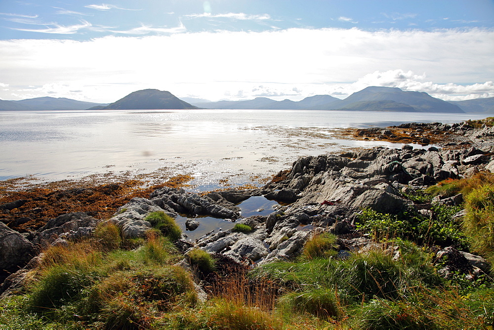 Sunlit rocks and foreshore, Helgoy, Kvalsund, Troms, North Norway, Norway, Scandinavia, Europe - 166-5486