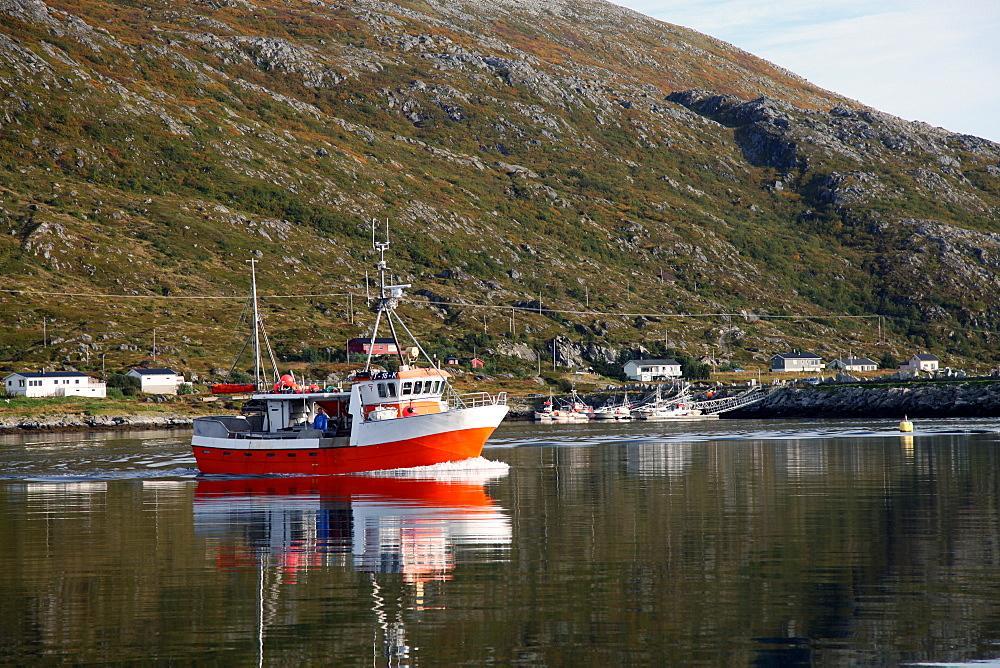 Fishing boat leaving Torsvaag, North Norway, Norway, Scandinavia, Europe - 166-5490