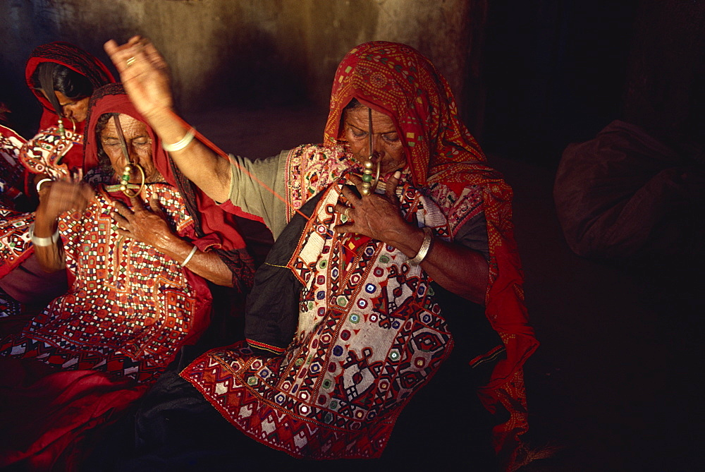 Muslim Jat tribes with gold nose rings, famous for embroidery work, Kutch district, Gujarat state, India, Asia