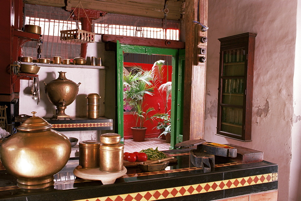 Kitchen area with traditional brass cooking utensils and samovar in restored traditional Pol house, Ahmedabad, Gujarat state, India, Asia