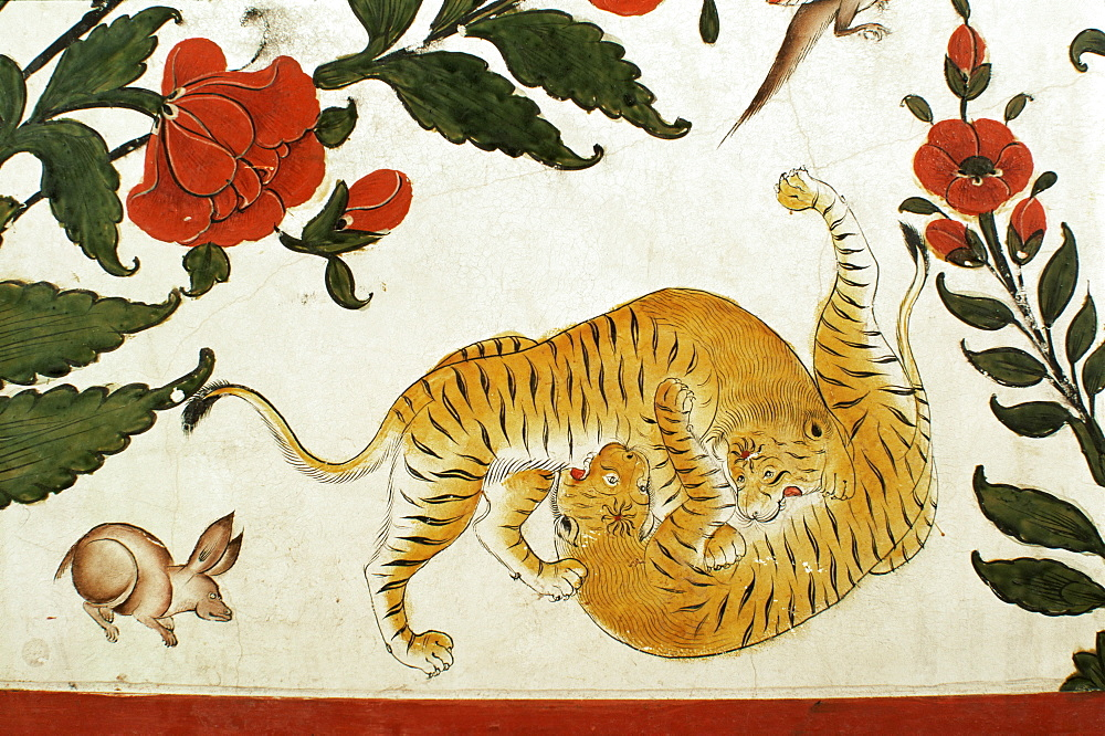 Detail of fighting tigers on painted dado in the Durbar Hall area of the palace, Samode Palace, Samode, Rajasthan state, India, Asia