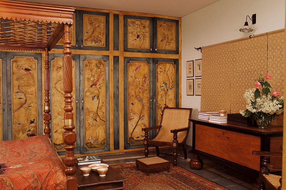 Colonial style bed, antique South Indian storage box, hand painted cupboards in home in Dehra Dun, Himalayan foot hills, Uttar Pradesh state, India, Asia