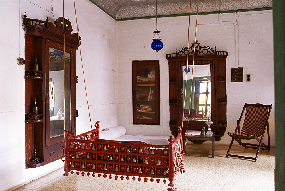 Seating area with traditional hitchkar suspended swing seat in restored traditional Pol house, Ahmedabad, Gujarat state, India, Asia