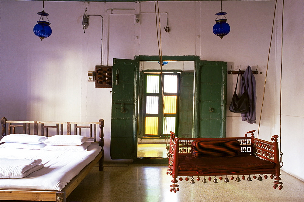 Bedroom with traditional hitchkar suspended swing seat in restored traditional Pol house, Ahmedabad, Gujarat state, India, Asia