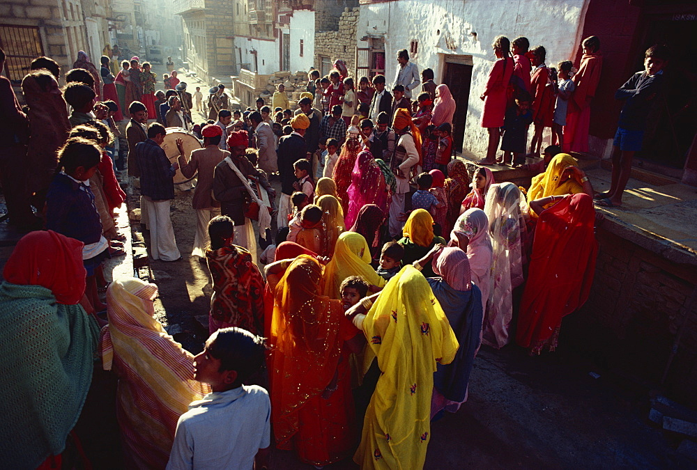 Family and friends gather to accompany a bride and bridgroom to their wedding, Jaisalmer, Rajasthan state, India, Asia