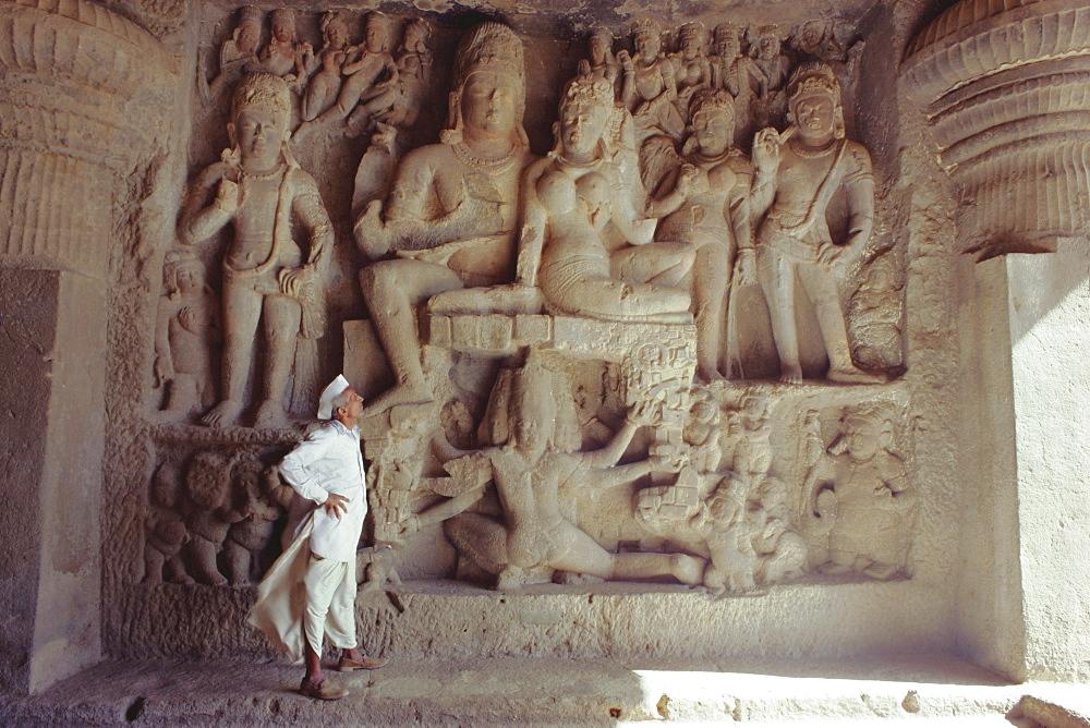 Rock cut panel depicting the Hindu God Lord Shiva and his wife Parvati, in Cave No 29, the Dhumar Lena Cave, at Ellora, Maharashtra State, India