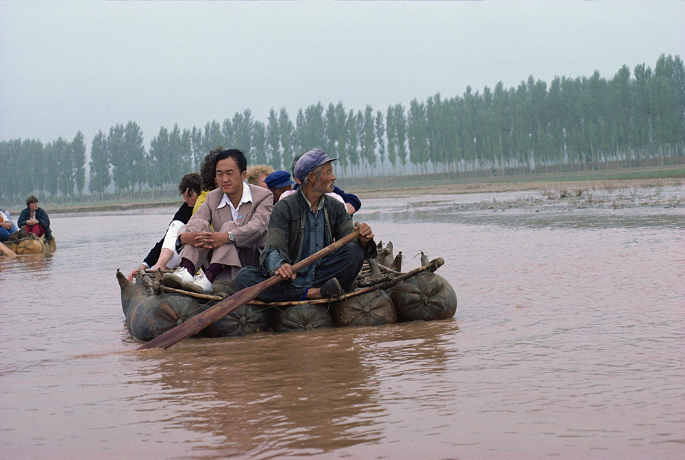 Pigskin rafts floating down the Yellow River, Ningxia Province, China, Asia - 188-3036