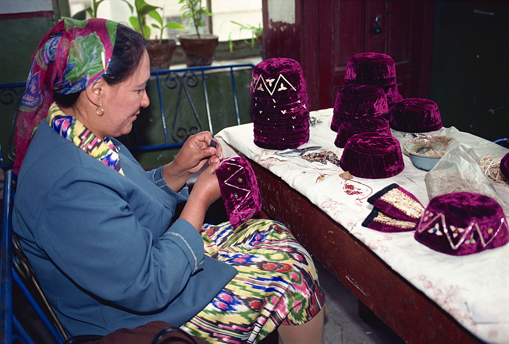 Uyghur woman making typical hats of the area, Kashi, China, Asia