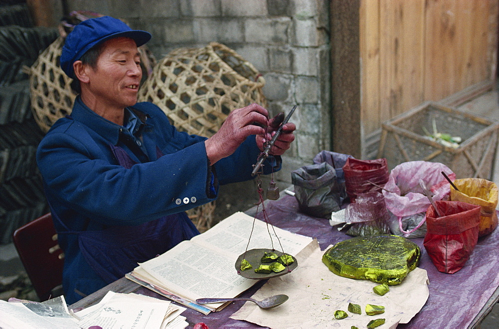Man selling chemical dyes for domestic textile industry, Kaili, Guizhou, China, Asia - 188-5207
