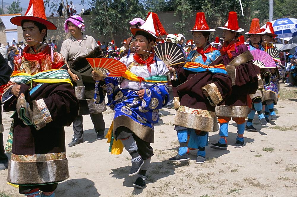 Tibetans dressed for religious shaman's ceremony, Tongren, Qinghai Province, China, Asia