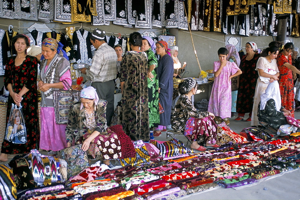Selling traditional textiles for weddings, Urgut, Uzbekistan, Central Asia, Asia