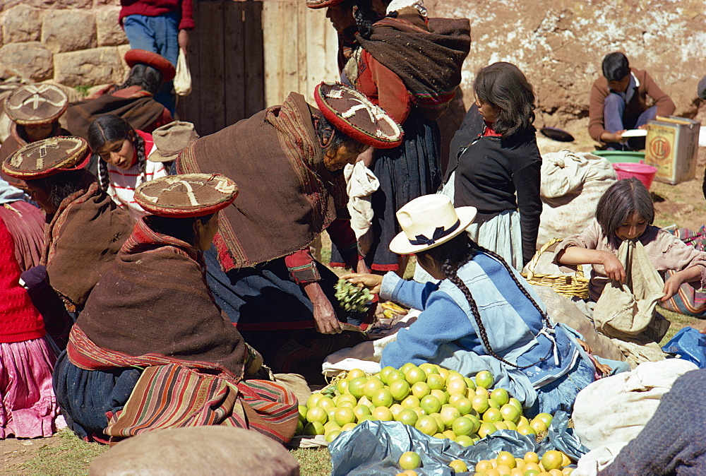 Groups of women selling fruit at the Sunday market at Chincheros in the Cuzco area, Peru, South America - 190-433