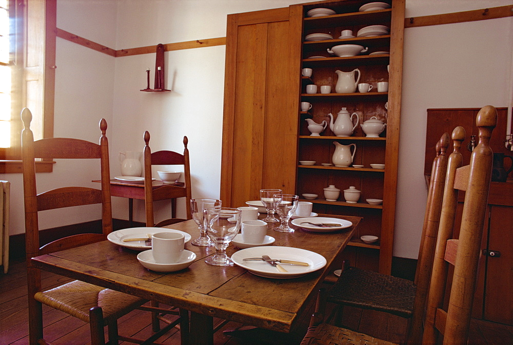 Interior with table, chairs, white china and cupboard in the Shaker Village of Hancock, Massachusetts, New England, United States of America, North America - 190-5887