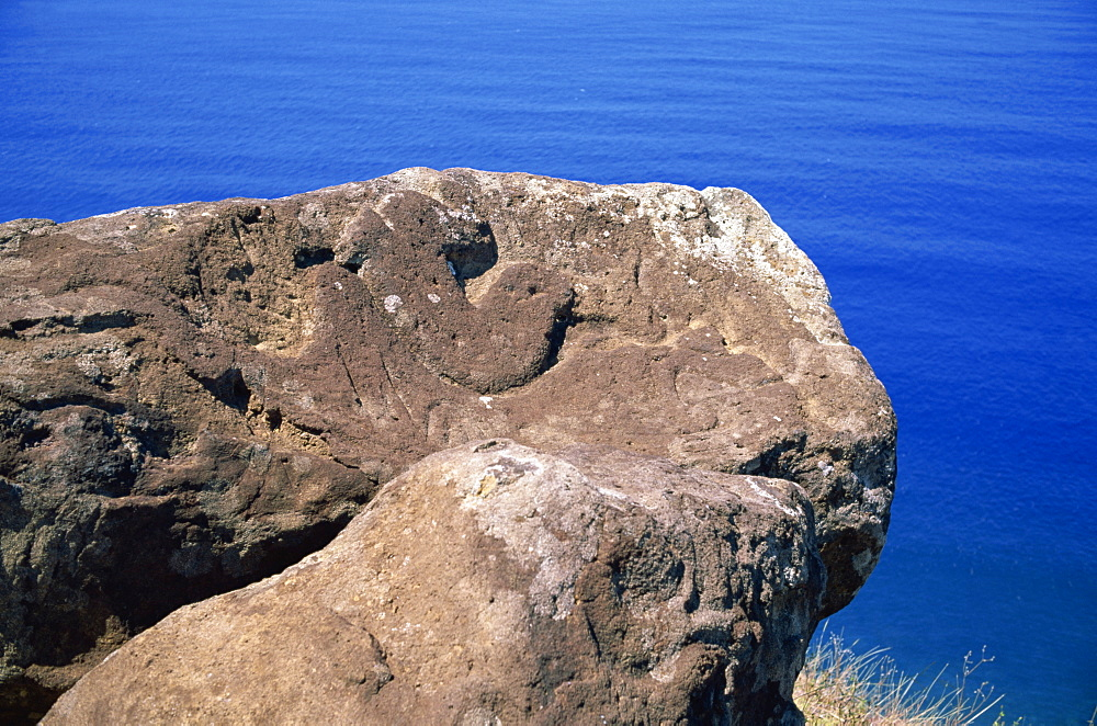 Close-up of the Bird Man petroglyph at Orongo ceremonial village on crater rim of Rano Kau on Easter Island (Rapa Nui), Chile, Pacific, South America