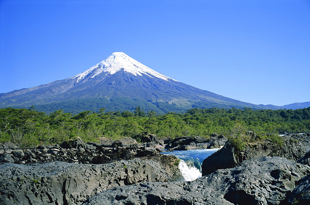 The cone of Volcan Osorno from the Petrohue Falls near Puerto Montt, Chile, South America