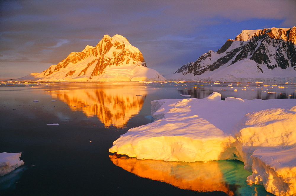 Iceberg lit by midnight sun, Antarctic Peninsula, Antarctica