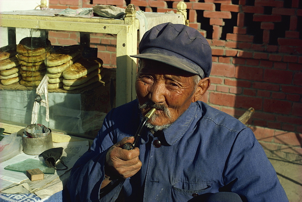 Man smoking pipe, Dunhuang, Gansu, China, Asia - 2-18475