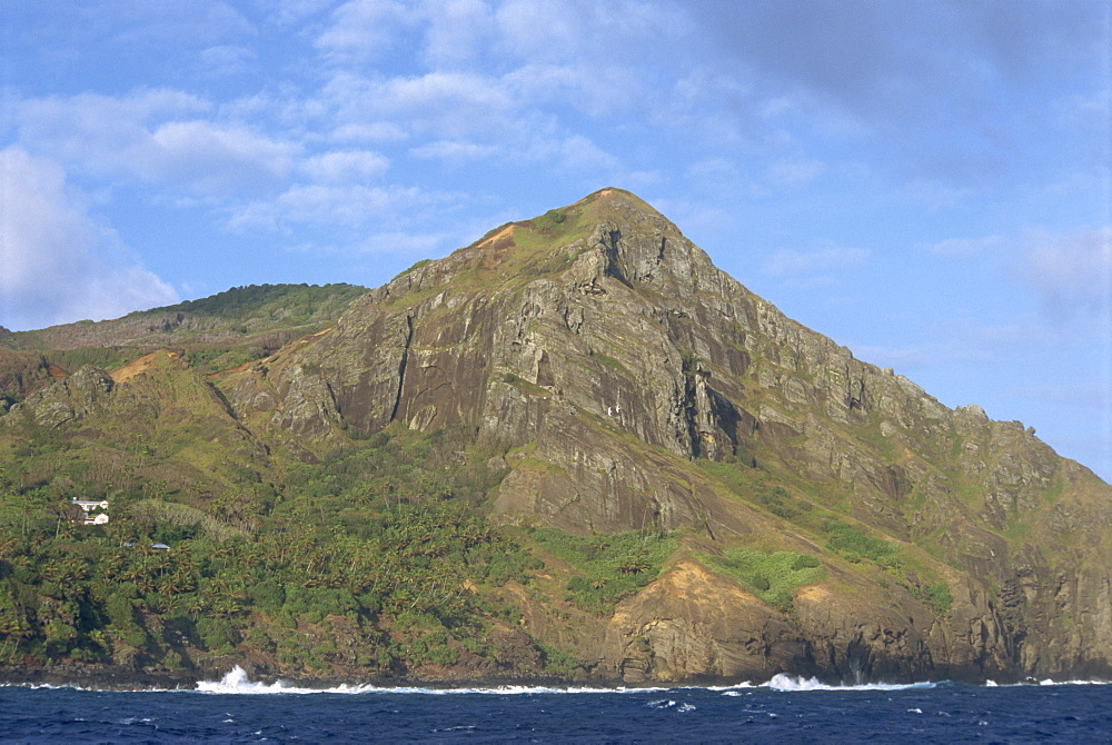 Landscape of coastline and rocky hills of Pitcairn Island, Pacific