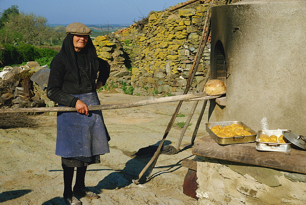 Woman baking bread, Alentejo, Portugal, Europe