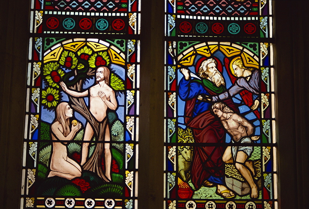 Stained glass of Adam and Eve, and Abraham preparing to sacrifice Isaac, St. Mary's church, Deerhurst, Gloucestershire, England, United Kingdom, Europe - 225-2619