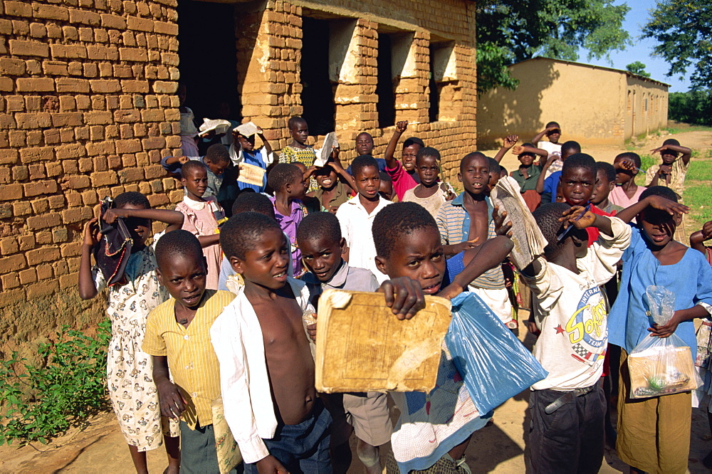 A group of children leaving the village school at Kande near Lake Malawi, Malawi, Africa
