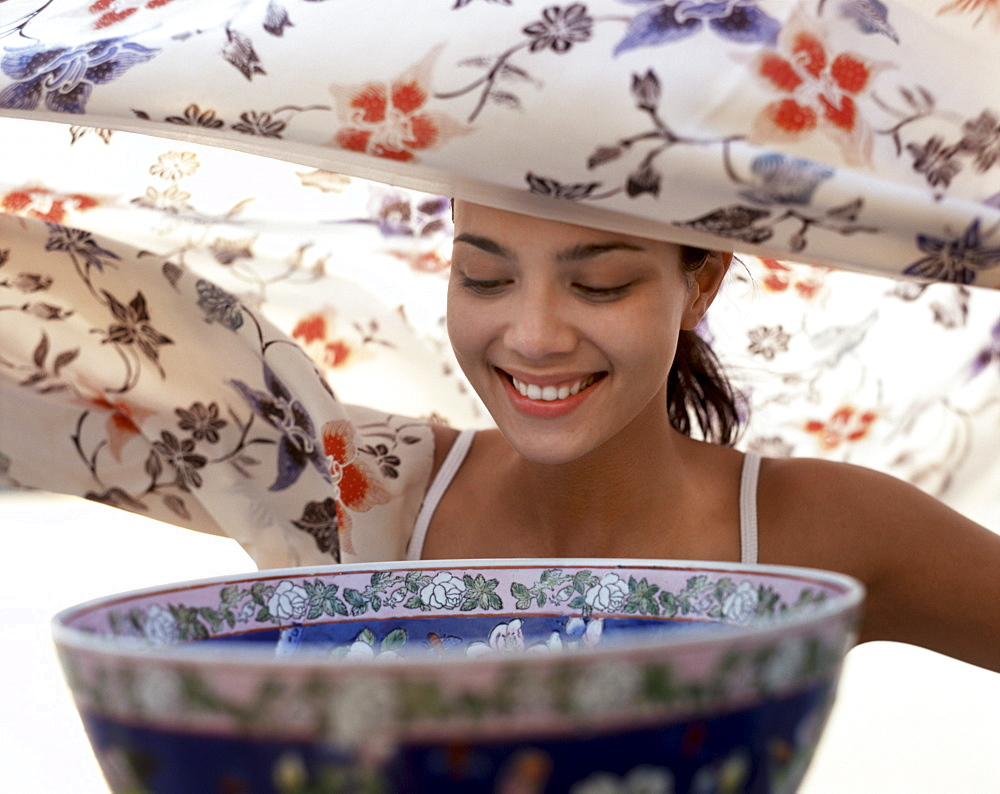 Aromatherapy, young woman prepares to inhale steam