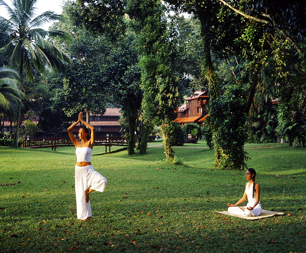 Girls doing yoga at Club Med, Cherating, Malaysia, Southeast Asia, Asia