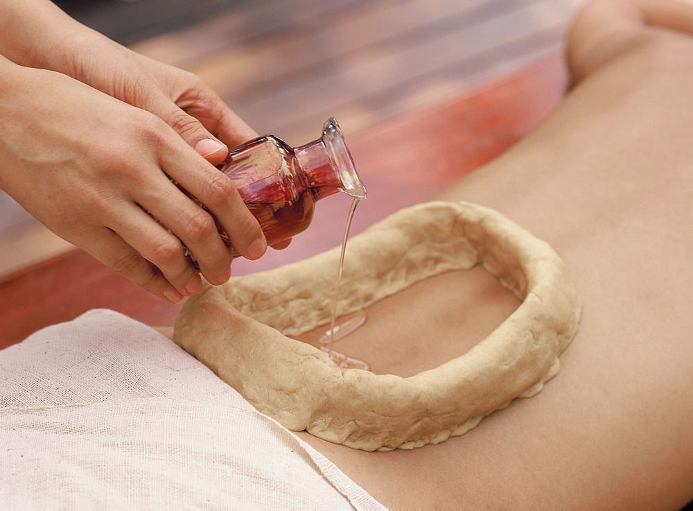 Kathi Vasti, an Ayurvedic treatment consisting of pouring medicated oil on various parts of the body and keeping it in place with a cup made of  dough