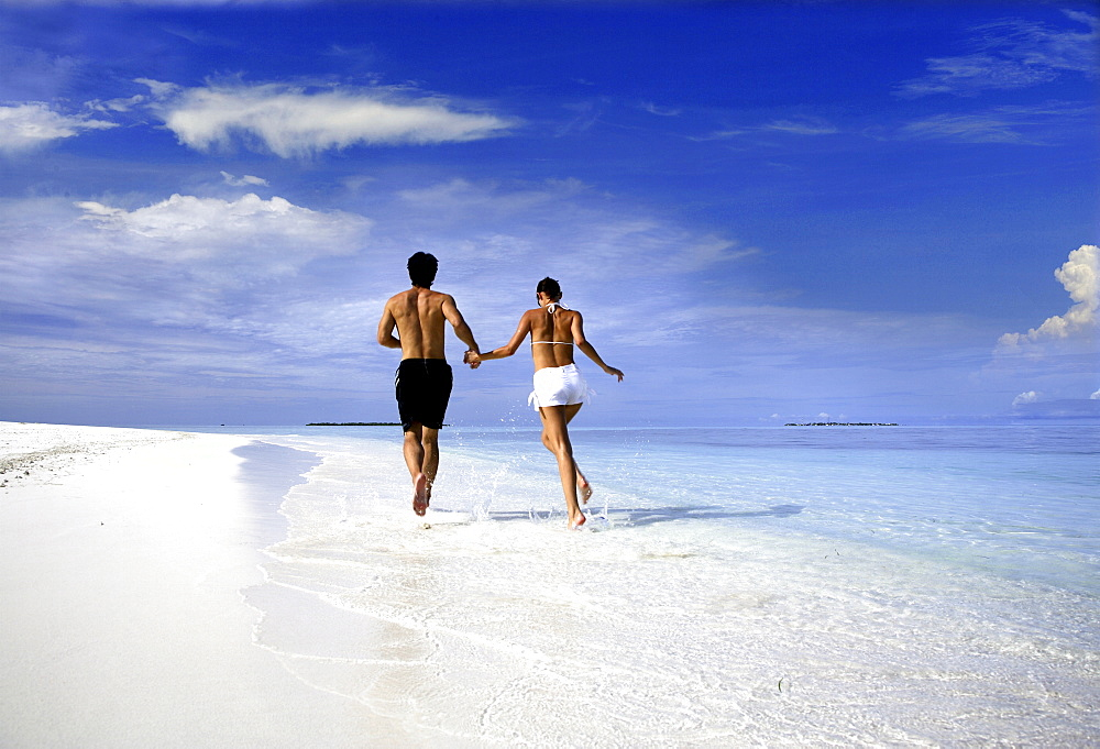 Couple running on a beach, Maldives, Indian Ocean, Asia - 238-6022