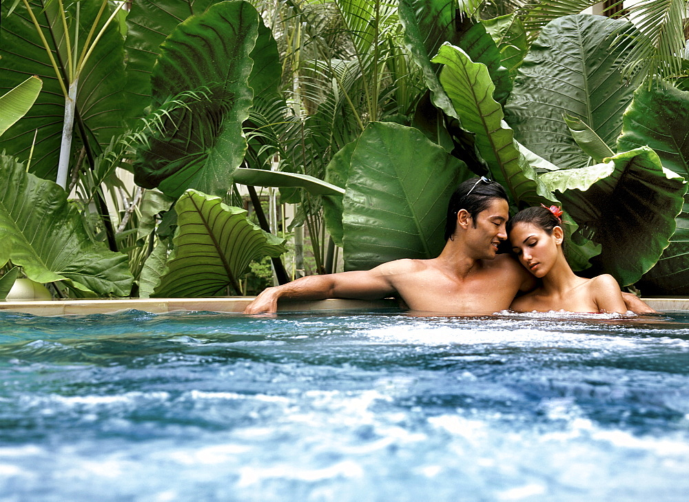 Couple in a jacuzzi, Maldives, Indian Ocean, Asia - 238-6023
